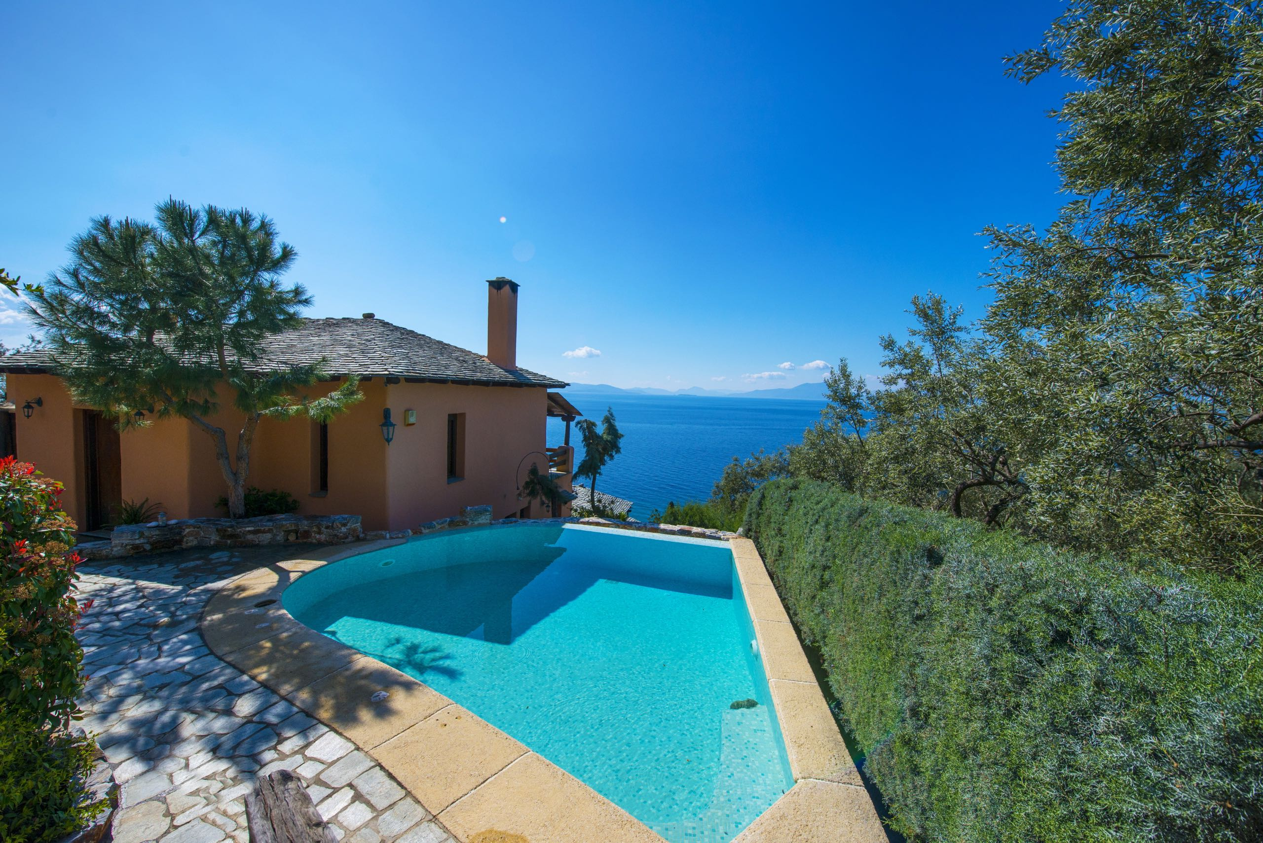 The private swimming pool of Villa 2 Cypresses in Pelion with amazing sea views.