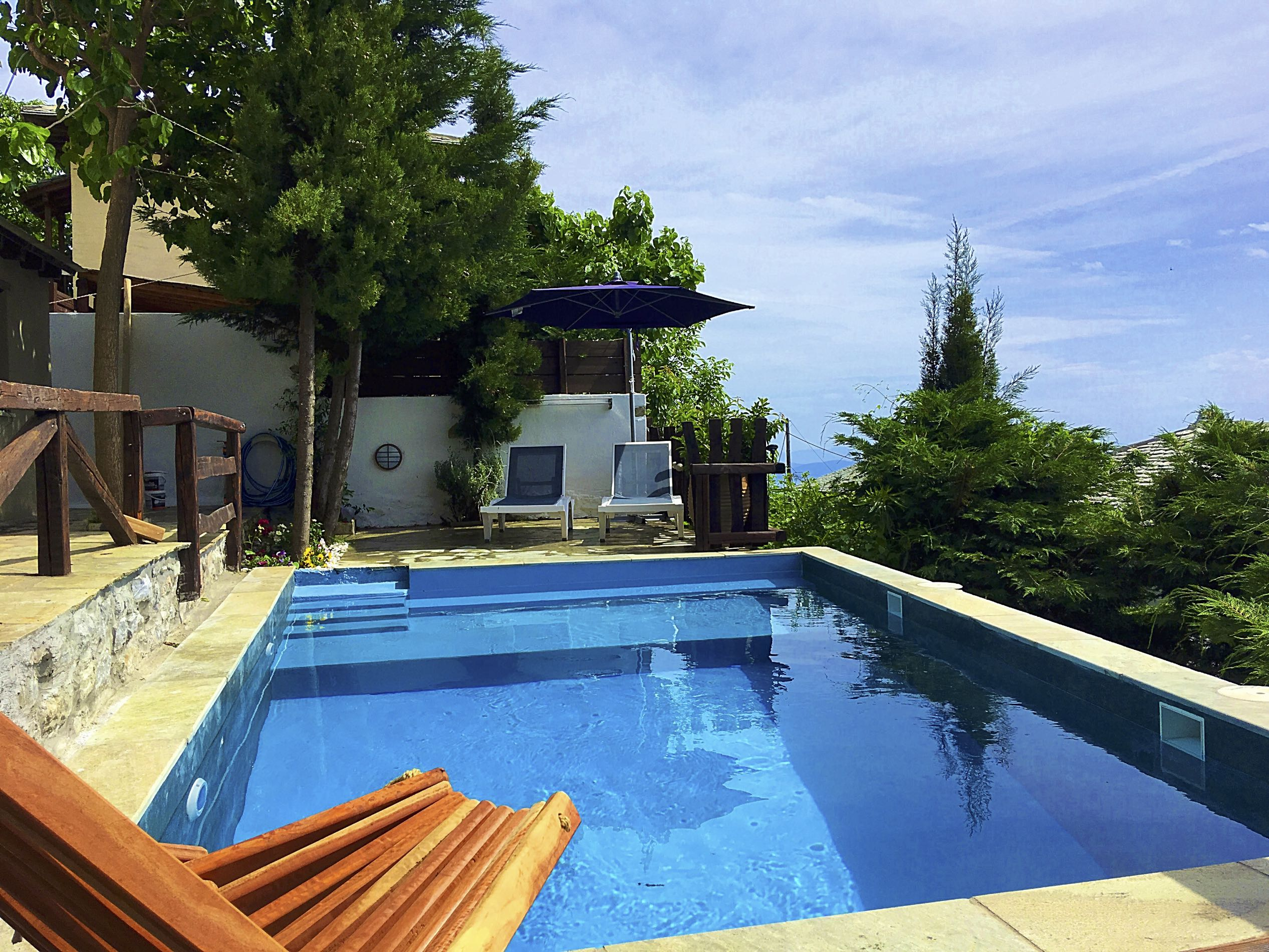 The exterior of Villa Thalia in Pelion with two levels and amazing sea views.