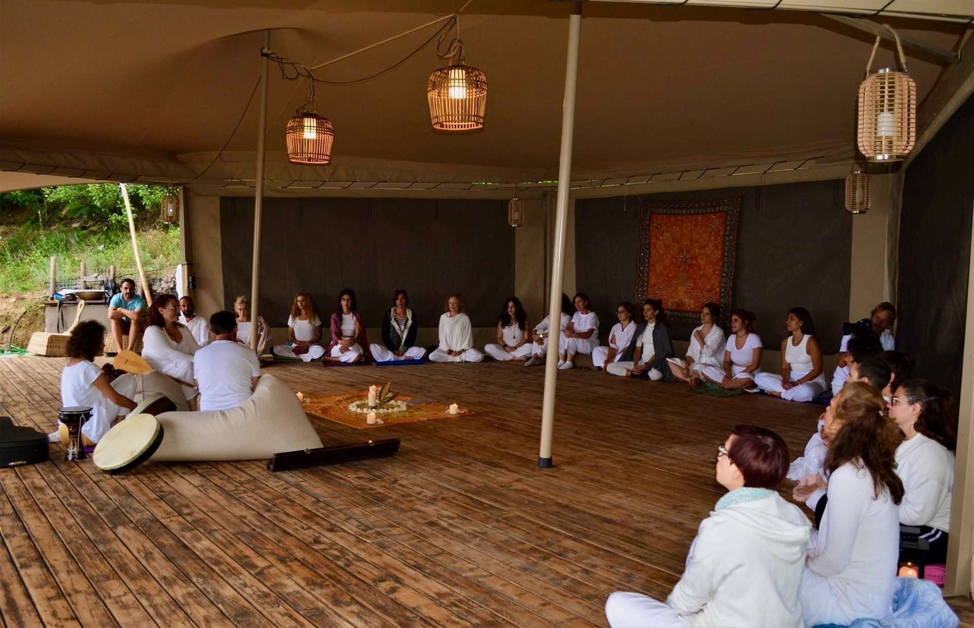 Yoga Science at Pelion Homes signing mantras inside the tent and Shala