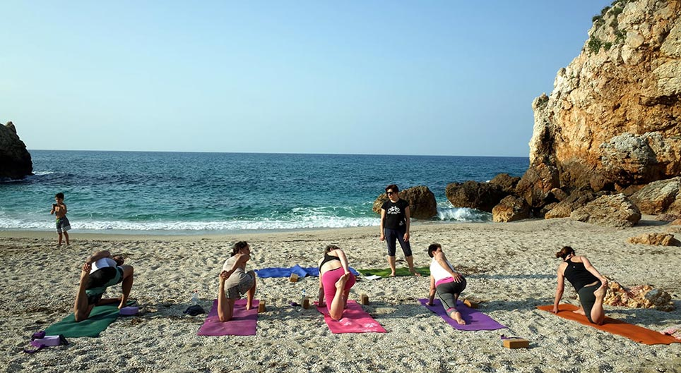 Yoga on the beach in Pelion with Pelion Homes